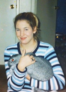 Me circa 2001, 10th grade, in my natural state -- too blond hair and posing with my enormous rabbit, Roxy.